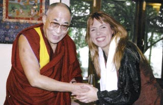 Isabel Losada together with the Dalai Lama