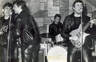 The Beatles, at the Cavern Club, with their former drummer Pete Best