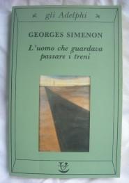 Copertina di L'uomo che guardava passare i treni di Simenon